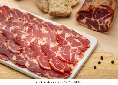 Sliced loin on ceramic cutting board. Spanish loin called lomo