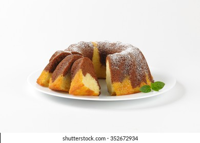 sliced marble bundt cake on white plate