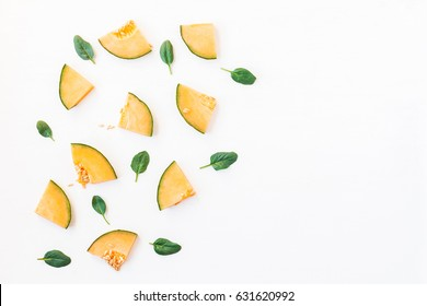 Sliced melon on white background. Flat lay, top view