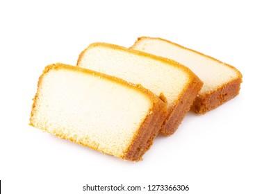Sliced moist butter cake isolated over the white background.