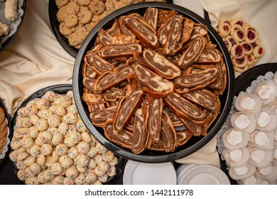 Sliced nut roll pastry on platter view from above