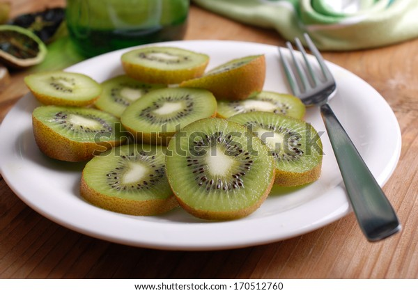 sliced ??kiwi on the plate, photographed close up