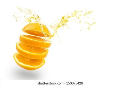 sliced of orange with splashing juice on white background