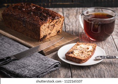 Sliced Paleo banana bread that is grain free and sugar free.  Enjoying with a cup of hot coffee