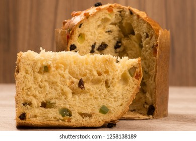 sliced panetone on brown background