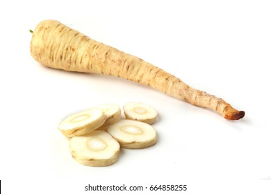 Sliced parsnip root isolated on white background