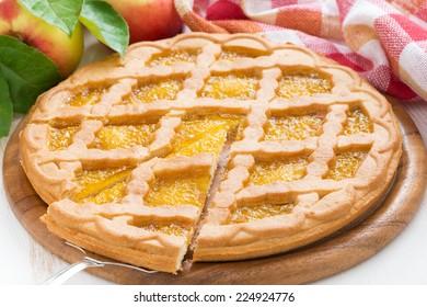 Sliced �¢??�¢??apple pie on white wooden table, horizontal