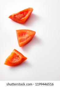 A sliced piece of ripe, fresh, red bell pepper with contact shadow, isolated on white background