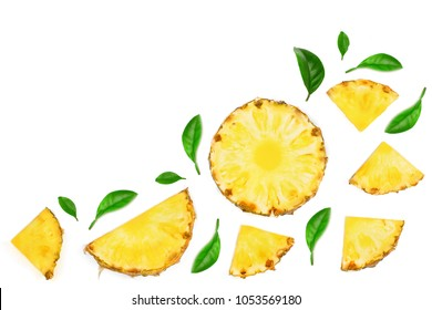 Sliced pineapple decorated with green leaves isolated on white background with copy space for your text. Top view.