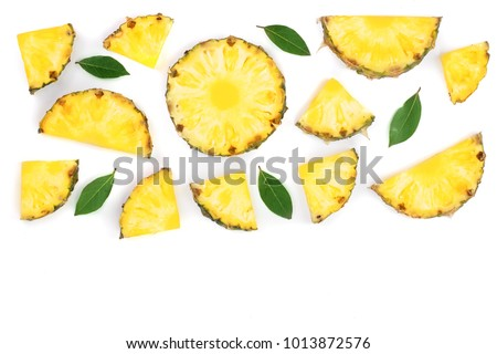 Sliced pineapple with green leaves isolated on white background with copy space for your text. Top view