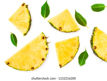 Sliced pineapple and green leaves pattern. Tropical pineapple summer fruit  isolated on white background. Top view