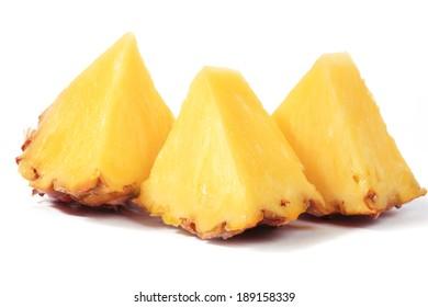 Sliced pineapple isolated on white/macro