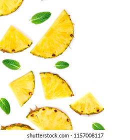 Sliced Pineapple Isolated.  Pineapple pieces  with green mint  leaves on white background. Flat lay. Summer concept