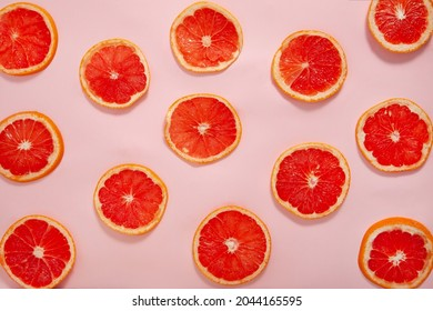Sliced pink grapefruit pattern on a solid pink background, healthy  raw food creative   - Shutterstock ID 2044165595