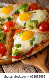 Sliced pizza with eggs, broccoli, tomatoes and parsley close-up on the table. Vertical
