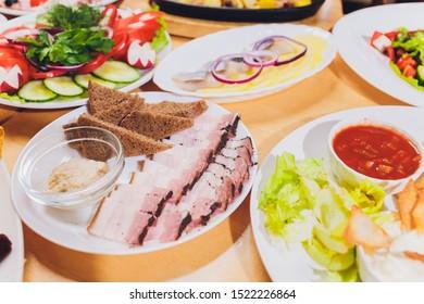 Sliced pork lard. Sliced bacon. Fat, tallow, grease, bacon. on the table