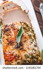 Sliced pork loin roasted . Recipe with herbs.