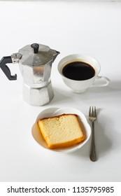 sliced of pound cake with black espresso coffee.