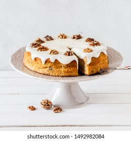Sliced Pumpkin Cake with Walnuts and Cream Cheese Frosting, square