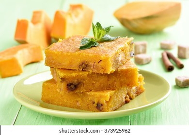 Sliced pumpkin pie decorated with mint