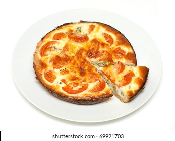 Sliced quiche with broccoli and tomatoes on a plate