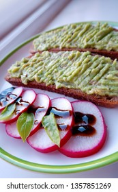 sliced radish and guacamole toasts on plate