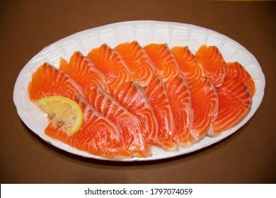 Sliced raw salmon fish, fresh salmon sashimi.