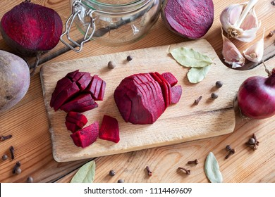 Sliced red beets with garlic and spices - ingredients to prepare fermented kvass