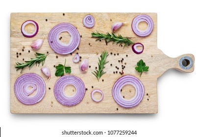 sliced red onion with spices and herbs  on  wooden cutting board isolated on white background. Top view
