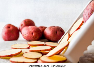 Sliced red potatoes close up on slicer