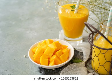 Sliced ripe mangoes with Lassi on side, selective focus