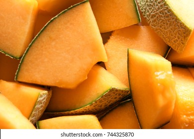 Sliced ripe melon as background