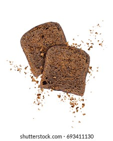 Sliced rye bread with crumbs frozen in the air, isolated on a white background