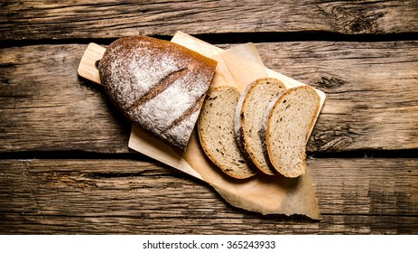 Sliced rye bread on a Board. On a wooden table. Top view