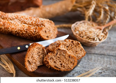 Sliced rye bread on a Board. On a wooden table.