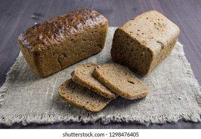 Sliced rye bread on the wooden background close up