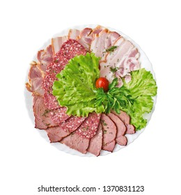 Sliced salami, bacon and ham with vegetables on a plate isolated. Top view