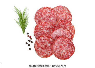 Sliced salami, dill and spices isolated on white background. Top view.