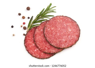 Sliced Salami with herbs and spices, isolated on a white background. Top view. - Shutterstock ID 1246776052