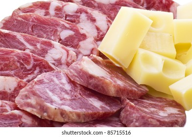 Sliced salami with piece of emmenthal cheese