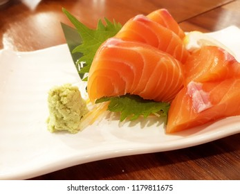 Sliced salmon sashimi served on wooden table