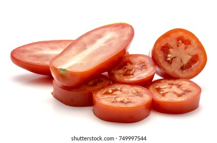 Sliced San Marzano tomato rings and two halves isolated on white background