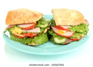 Sliced sandwich with ham and vegetables isolated on white