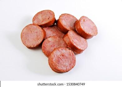 sliced sausage on white background