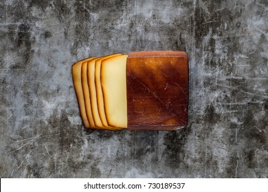Sliced smoked cheese