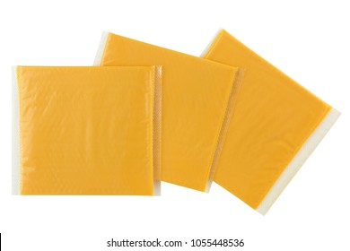 Sliced Smokey BBQ processed cheese, single slice wrapped in clear transparency plastic package isolated on white background