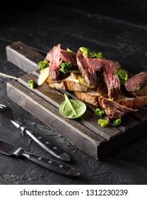 Sliced steak on a wooden board
