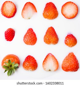 Sliced strawberries on a white plate