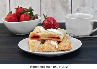Sliced strawberry cheese strudel with fresh strawberries.
