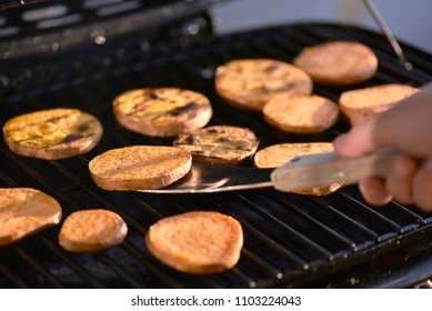 Sliced sweet potato on grill, staple superfood.